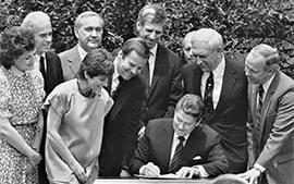 President Ronald Reagan signs legislation to change the national drinking age from 18 to 21